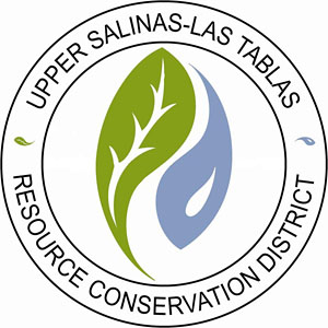 Logo of Upper Salinas-Las Tablas Resource Conservation District, with curved green leaf tree and blue water-drop whale graphics.