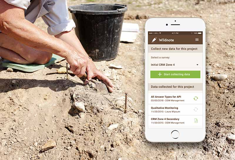 screen shot of wildnote mobile app showing data collection for cultural resources management overlayed on image of a person excavating an artifact with a trowel