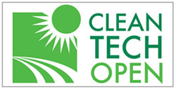 Clean Tech Open Logo of stylized sun over landscape in green.